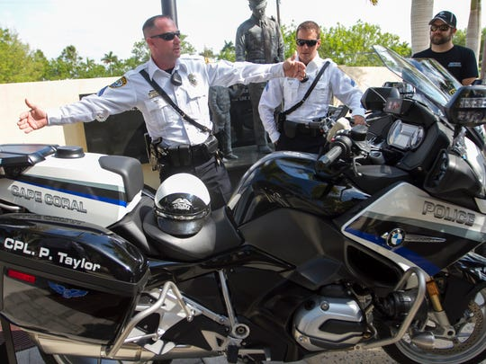 Cpl. Patrick Taylor of the Cape Coral Police Department describes the features on the department's new BMW motorcycles Wednesday in Cape Coral.