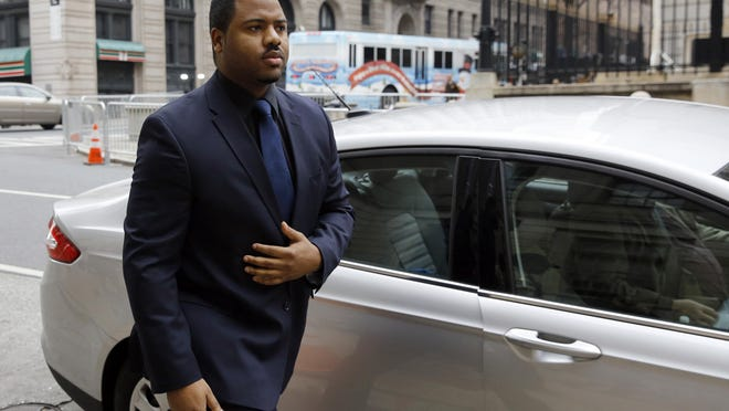 Officer William Porter, one of six Baltimore city police officers charged in connection to the death of Freddie Gray, walks into a courthouse during jury deliberations, Wednesday, Dec. 16, 2015, in Baltimore. Jurors are in their third day of deliberations in the manslaughter trial of Porter. (AP Photo/Patrick Semansky)