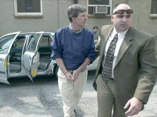 Gregory Harry Neff, 53, is brought in the back door of the York County Courthouse in 2001 after being charged with murder in connection with the death of Lillie Belle Allen during the race riots in York in 1969.