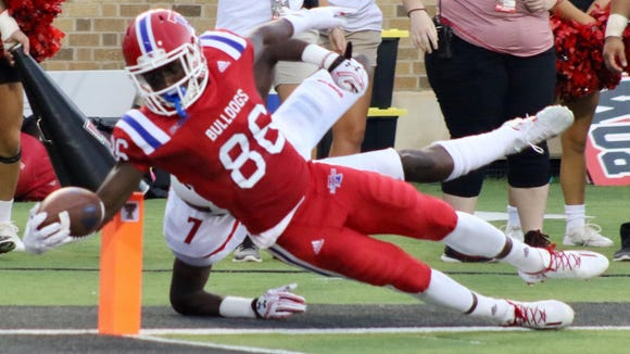 Louisiana Tech wide receiver Rhadshid Bonnette reaches the ball toward the end zone in Saturday's loss to Texas Tech.