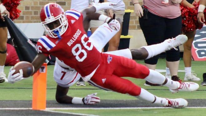 Louisiana Tech wide receiver Rhadshid Bonnette reaches the ball toward the end zone in Saturday's loss to Texas Tech.
