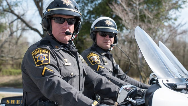 DFC Steve Ray, left, and DFC Jeff Chase pose for photo at the Wicomico County Sheriff's Office on Monday, March 13, 2017.