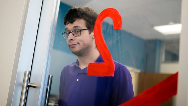 Harrison Brown, 19, a student at Rowan College at Burlington County and an autistic comedian, poses in the Student Success Center.