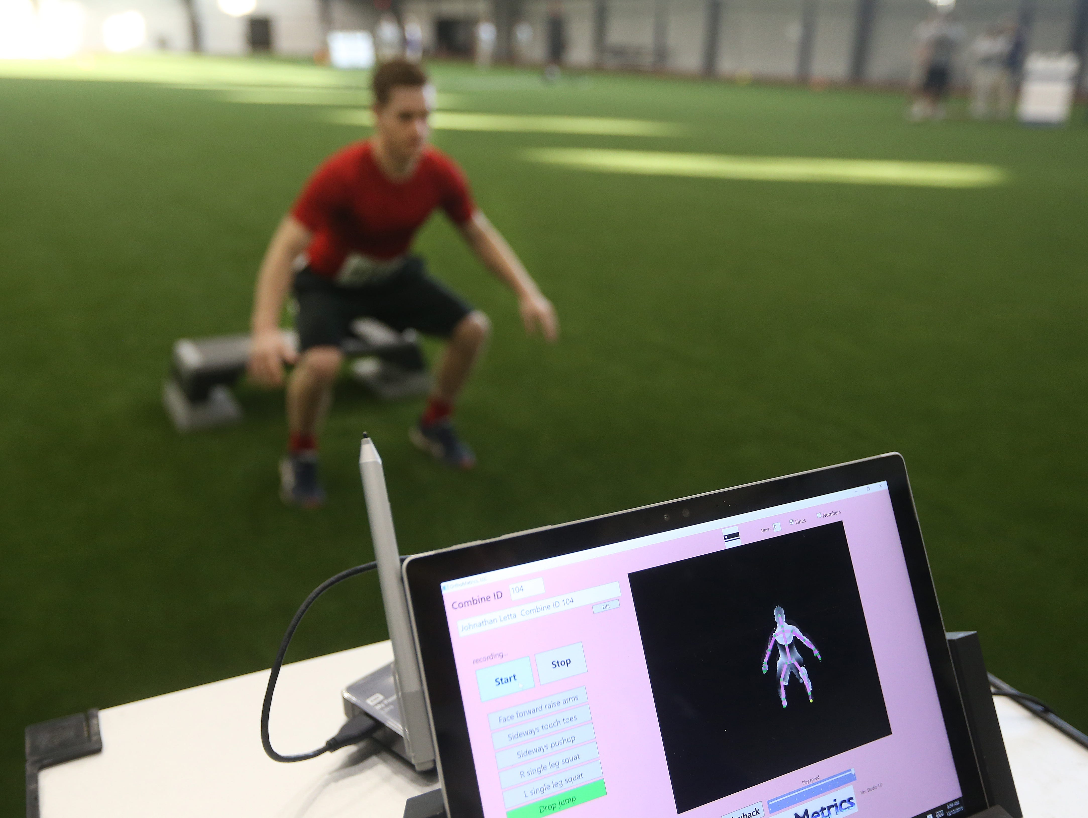 UR Medical staff uses computers to scan athletes during the AGR Sports Combine.