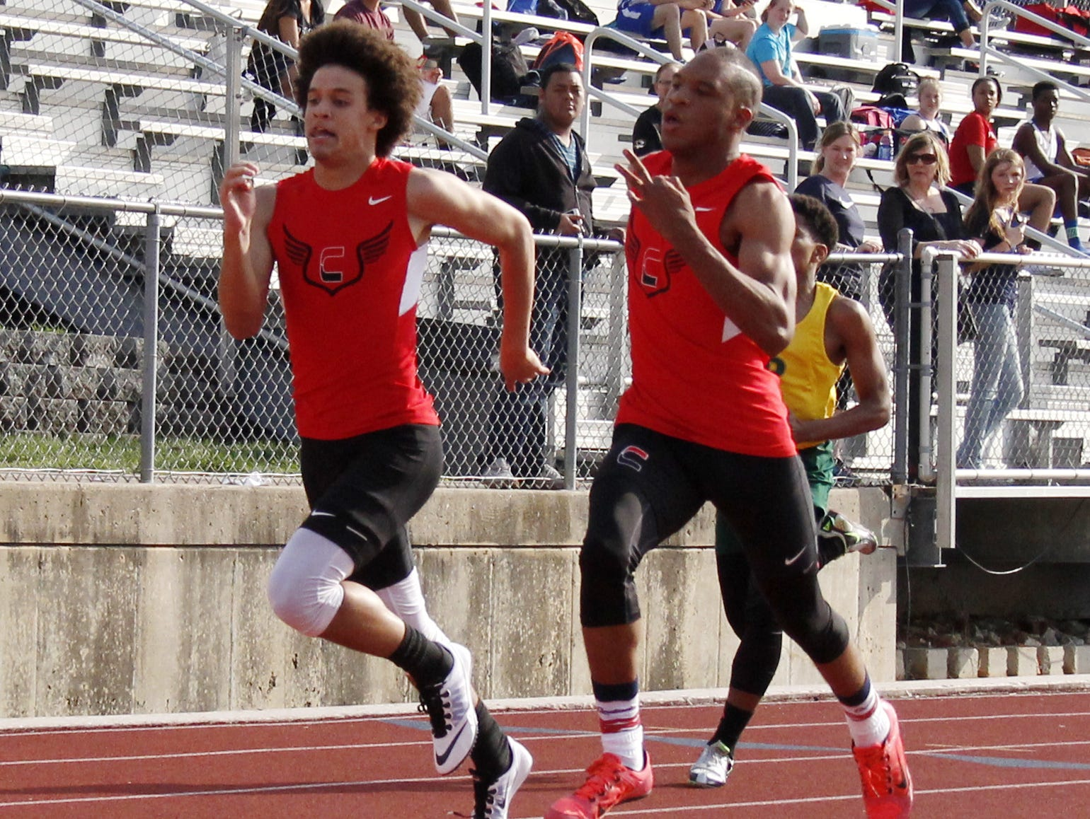 From left, Central freshman Quintin Batson and senior Lyndon Heard raced to a photo finish at the All-City warm up track and field meet Thursday at JFK Stadium, with Heard edging Batson at the finish line.