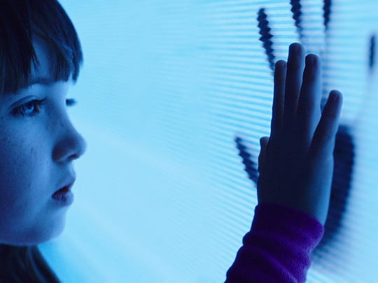 """This photo provided by Twentieth Century Fox shows, Kennedi Clements as Madison Bowen, reaching out to apparitions that have invaded her family's home in a scene from the film, """"Poltergeist."""" (Twentieth Century Fox  via AP)"""