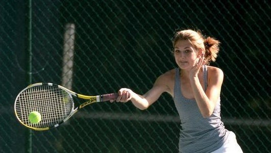 Roberson's Abby Roberts returns a shot Wednesday at Asheville School.