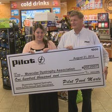 Check presentation to the Muscular Dystrophy Association