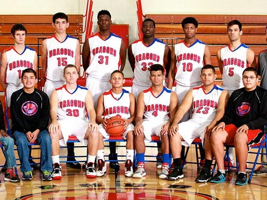 Javier DiGonzalez (bottom row, second from left) is a team manager for the Florida School for the Deaf & Blind's basketball team. The FSDB Dragons have 11 athletic offerings among the school's many extracurricular activities.