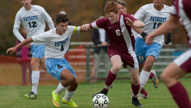Freehold Township's Jake Kennis and Toms River South's Cameron Geerinck battle for ball during first half action. Toms River South Boys Soccer vs Freehold Twp. in SCT Quarterfinal game in Freehold, NJ on October 27, 2015.
