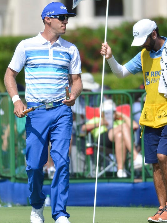 Graham DeLaet walks off No. 9 after putting out during the third round of the RBC Heritage golf tournament Saturday, April 15, 2017, at Harbour Town Golf Links on Hilton Head Island, S.C. (Jay Karr/The Island Packet via AP)/The Island Packet via AP)