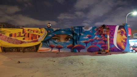 The first major public mural for Arab-Americans in metro Detroit painted by artist Dasic Fernandez is worked on the side of Sheeba Middle Eastern Cuisine restaurant in Hamtramck on Monday Dec. 9, 2013.