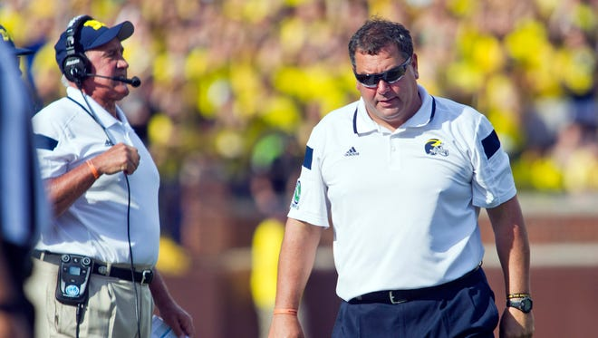 Michigan head coach Brady Hoke, right, reacts on the sideline next to defensive coordinator Greg Mattison, left, in the second quarter against Minnesota in Ann Arbor, Mich., Saturday, Sept. 27, 2014.