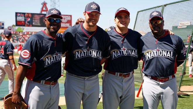 (Left to right) Reds All-Stars Brandon Phillips, Scott Rolen, Joey Votto and Arthur Rhodes pose for a photo at Angel Stadium of Anaheim in July of 2010.