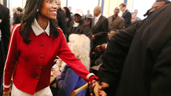 Judge Tracie Hunter smiles after she became a convicted felone last month.