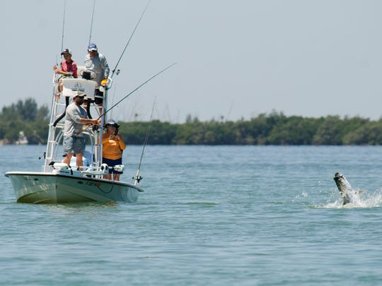 """A team in the """"Ding"""" Darling and Doc Ford's Tarpon"""