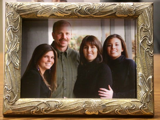 A family portrait shows Gregg Hawkins, who was shot