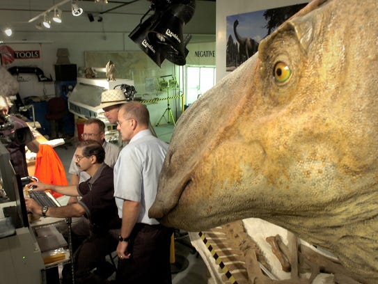 Technicians from the Eastman Kodak Company and paleontologist