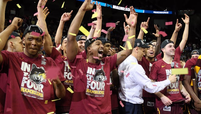 Mar 24, 2018; Atlanta, GA, USA; The Loyola Ramblers celebrate after defeating Kansas State Wildcats in the championship game of the South regional of the 2018 NCAA Tournament at Philips Arena. Mandatory Credit: Brett Davis-USA TODAY Sports