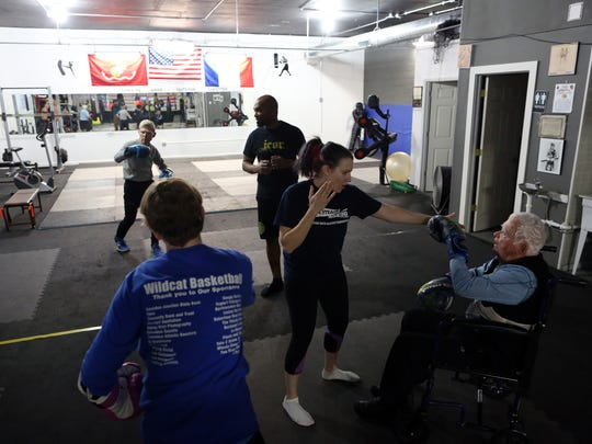 Clif Johnson and Emily Klinefelter lead a Rock Steady Boxing class at ICOR Boxing on Wednesday, Nov. 29, 2017. The class helps clients with Parkinson's Disease address symptoms with strength and agility exercises. The class helps clients with Parkinson's Disease address symptoms with strength and agility exercises.