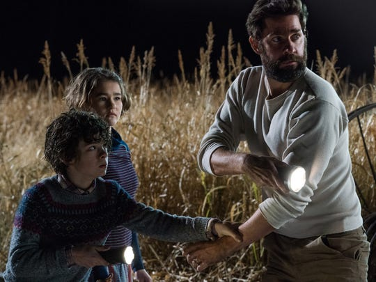 "Lee (John Krasinski) gets his kids (Noah Jupe and Millicent Simmonds) out of harm's way in ""A Quiet Place."""