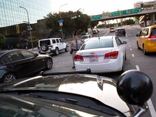 Highway Patrol Officer Benjamin Gomez helps a stranded