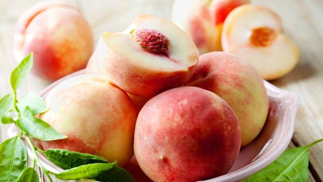 White peaches in a bowl.