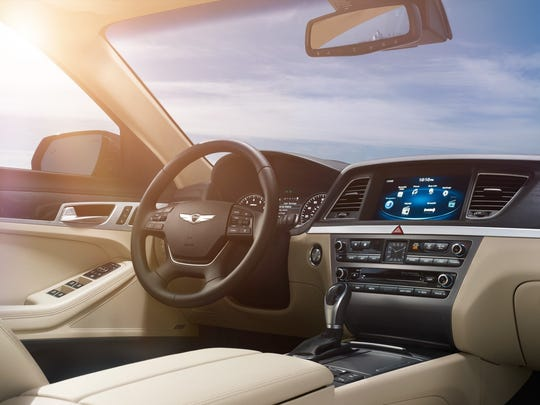 The interior of the 2015 Hyundai Genesis features heated/cooled front seats, power tilt/telescope leather-wrapped steering wheel and power panorama sunroof.