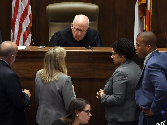 Judge Prentiss Harrell speaks with attorneys in the