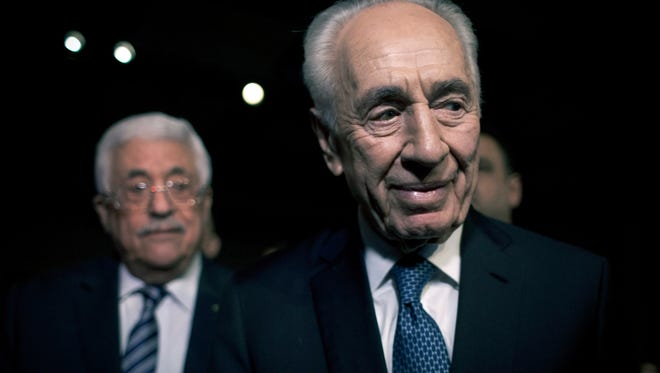 In this May 22, 2015, file photo, former Israeli President Shimon Peres, right, and Palestinian President Mahmoud Abbas arrive to attend the opening session of the World Economic Forum at the King Hussien convention center, Southern Shuneh, Jordan. Shimon Peres, a former Israeli president and prime minister, whose life story mirrored that of the Jewish state and who was celebrated around the world as a Nobel prize-winning visionary who pushed his country toward peace, has died, the Israeli news website YNet reported early Wednesday, Sept. 28, 2016. He was 93.