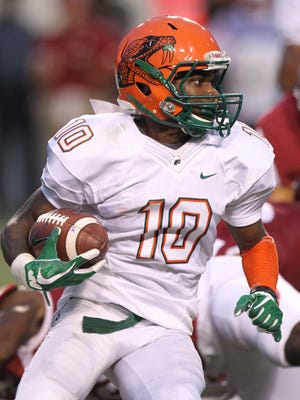 Florida A&M Rattlers kick returner Orlando McKinley (10) on a return in the first quarter against the Arkansas Razorbacks at War Memorial Stadium. The team is being penalized a time out each quarter for jerseys that violate the rules.