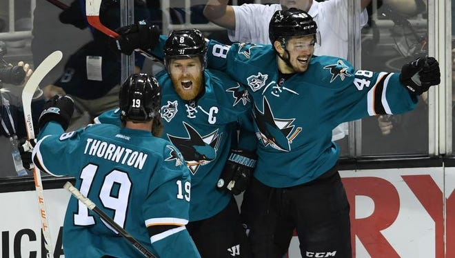 Joe Pavelski of the San Jose Sharks celebrates his goal against the St. Louis Blues with Joe Thornton (19) and Tomas Hertl (48).