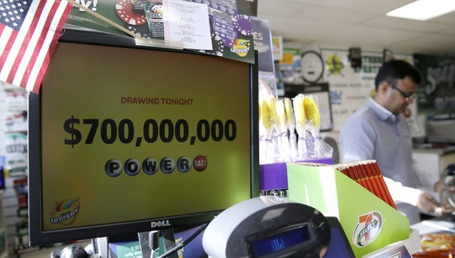 A Powerball lottery sign displays the lottery prizes at a convenience store Wednesday, Aug. 23, 2017, in Northbrook, Ill. Lottery officials said the grand prize for Wednesday night's drawing has reached $700 million, the second -largest on record for any U.S. lottery game.