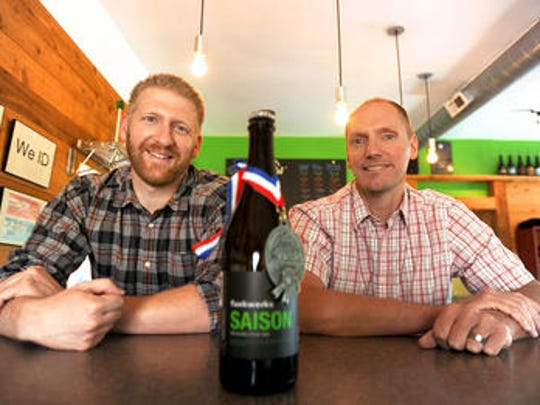 Funkwerks owners Brad Lincoln, left, and Gordon Schuck are pictured in their taproom with the Saison Belgian Style Ale.