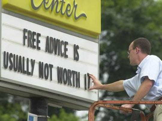 In 2003, Craig Fisher places the letter T to finish his advice quote on the Taylor Rental Center sign located on Rt. 38 and Marter Ave.