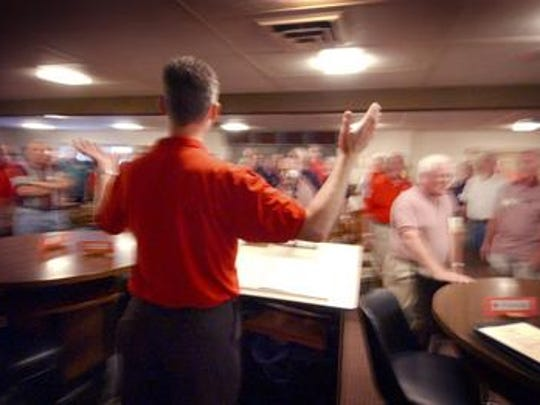 Joe Stubbe directs barbershop singers in this file photo from Wausau.