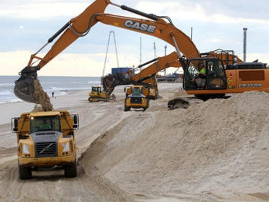 Sand is replaced Friday afternoon, January 27, 2017, along the coastline at Harding Avenue in Ortley Beach after it was washed away by this weeks Nor'easter.