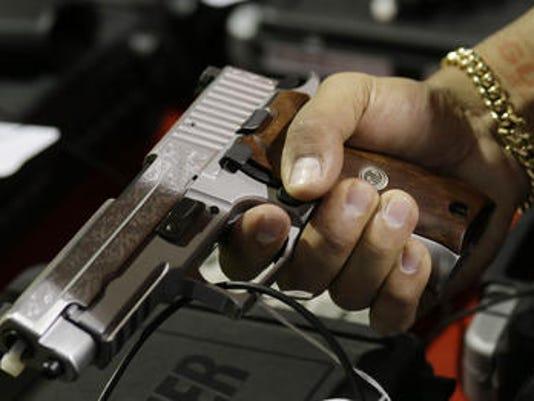 636328714747836880-gun.jpg