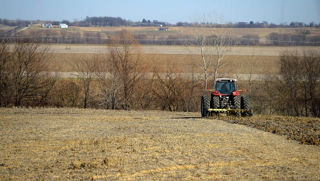 In this Friday, Dec. 8, 2017 photo, Joe Lau works on a field on the east side of St. Joseph, Mo. Lau farms around 1,200 acres in six area counties.
