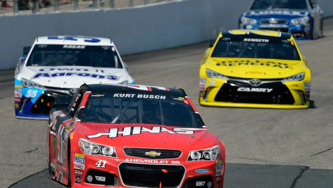 NASCAR Sprint Cup Series driver Kurt Busch (41) races in front of NASCAR Sprint Cup Series driver David Ragan (55) and NASCAR Sprint Cup Series driver Matt Kenseth (20) during the 5-Hour Energy 301 at New Hampshire Motor Speedway.