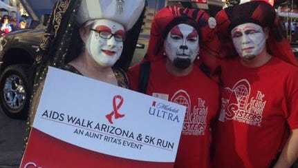 From left: Opa Lez, 25, Raisa Brau, 33, and Gabby Le Ankles, 43, participate in Sunday's AIDS Walk Arizona and 5K Run.