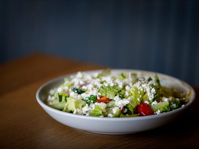Greek Salad with tomatoes, cucumber, onion, olives,