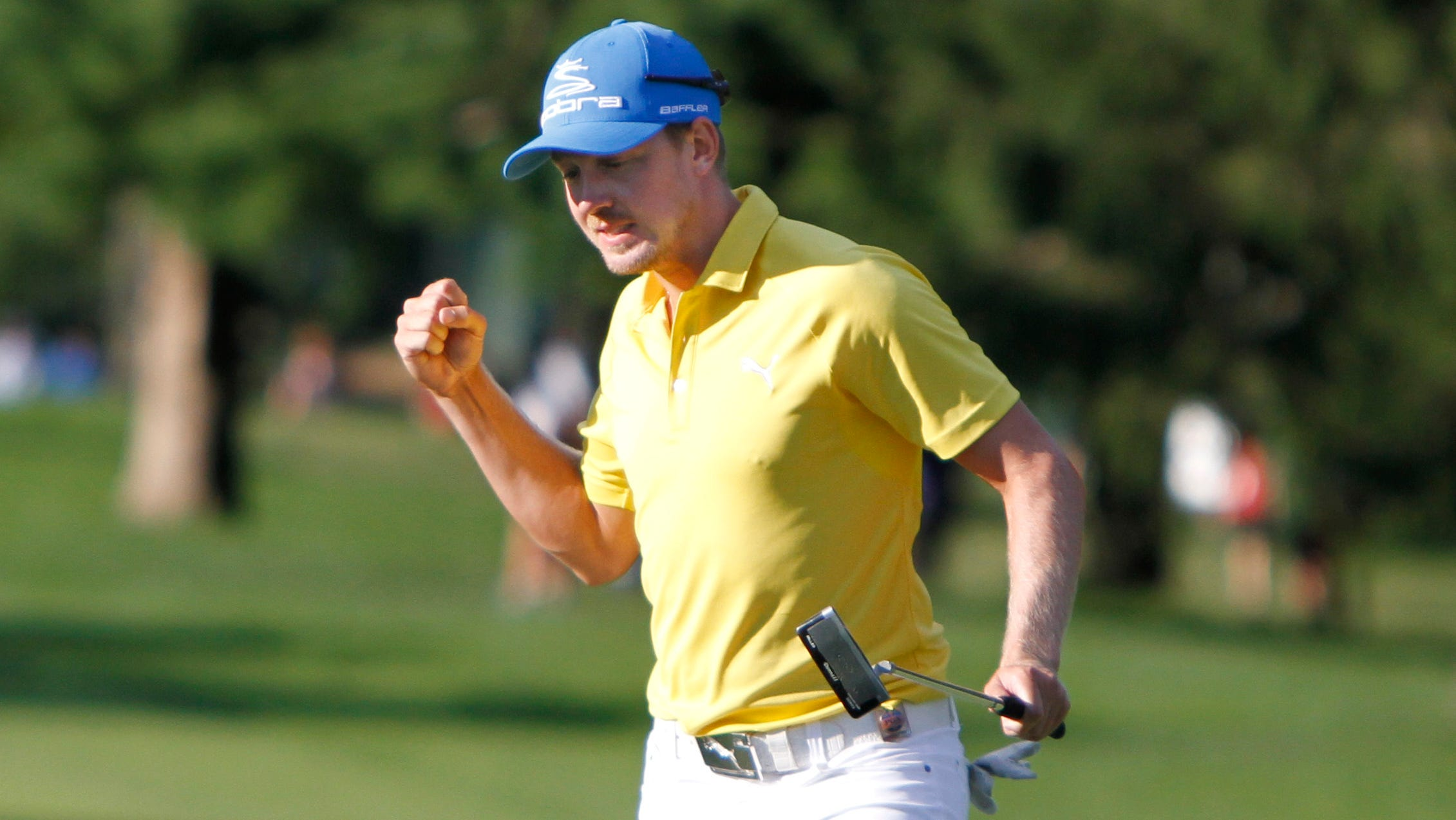 Jonas Blixt pumps his fist after sinking a long birdie putt on the 16th during the final round of the 95th PGA Championship Sunday, Aug. 11, 2013 at Oak Hill Country Club in Pittsford.