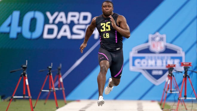 Georgia linebacker Roquan Smith runs the 40-yard dash at the NFL scouting combine in Indianapolis on March 4, 2018.