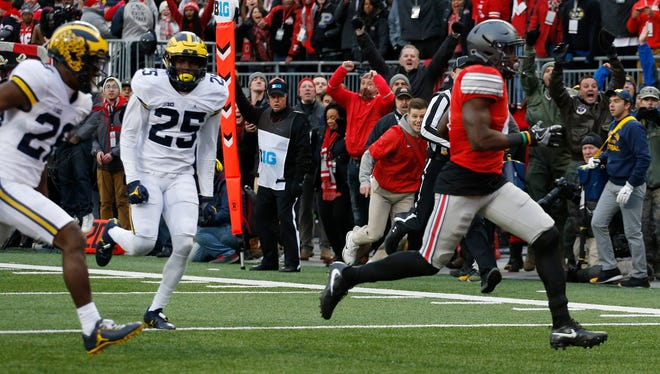 Ohio State running back Curtis Samuel scores a touchdown against Michigan during the second overtime of of their game Saturday in Columbus. Ohio State won 30-27 in double overtime.