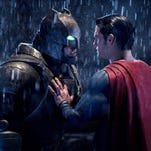 """This image released by Warner Bros. Pictures shows Ben Affleck, left, and Henry Cavill in a scene from, """"Batman v Superman: Dawn of Justice."""""""