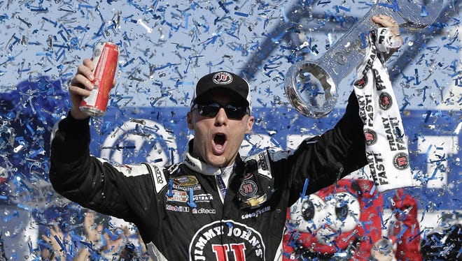 Kevin Harvick celebrates in Victory Lane after winning a NASCAR Sprint Cup series auto race Sunday in Las Vegas.