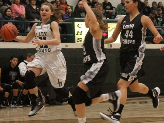 Sabina Judah, left, races past some Mescalero defenders on Thursday night.