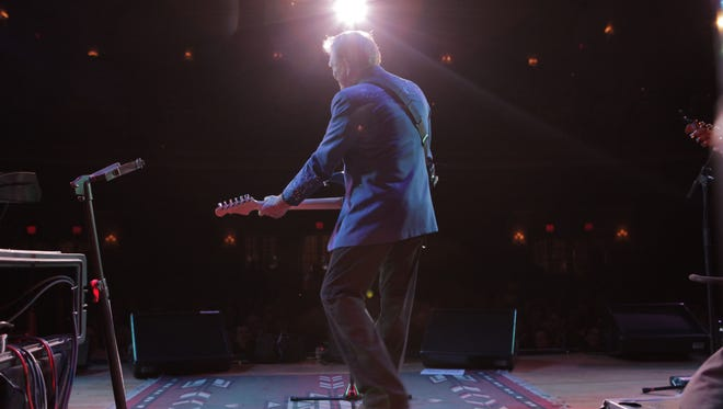 """Glen Campbell on stage performing in the movie """"Glen Campbell: I'll Be Me"""" which shows his journey with Alzheimer's disease."""