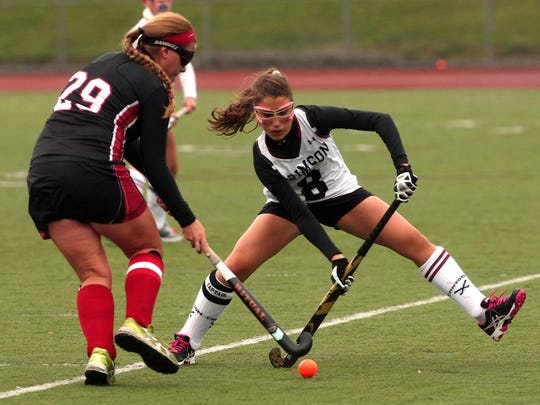 Boonton's Chelsea Davis and Morristown-Beard's Bella Cuomo battle for the ball during their  field hockey matchup in the MCT second round. October 3, 2015, Morristown, NJ.